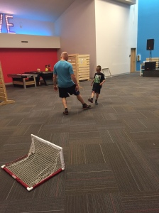 Alan playing hoverball with Christian